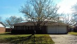 Front view of 3 bedroom, 2 bath, 2 car garage home with 1345 square feet.